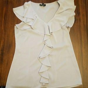 Lilac color feminine sleeveless blouse